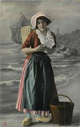 Dutch girl looks front, letter held with both hands, basket on back & another by her left foot, red overskirt, with green stripes behind, bl/w  background of coast & sailing ship