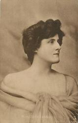 MISS HILDA HANBURY facing slightly right, hands under chin, looking front/up