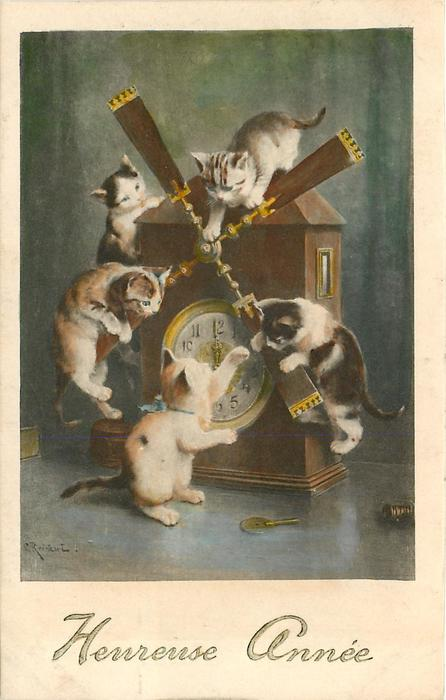 five kittens play with clock