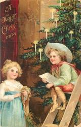 A HAPPY CHRISTMAS, boy sits on step-ladder, girl stands lower left, tree back right