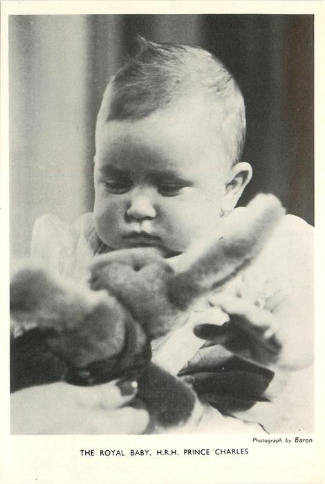 THE ROYAL BABY, H.R.H. PRINCE CHARLES baby looking down at a plush rabbit