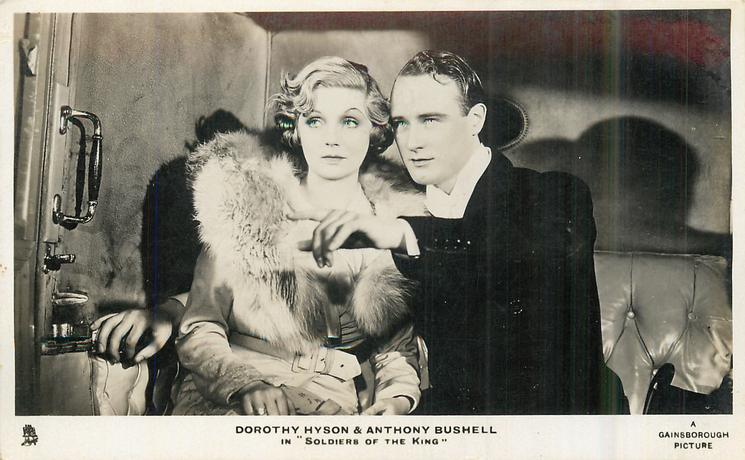 "DOROTHY HYSON & ANTHONY BUSHELL IN ""SOLDIERS OF THE KING"" he points & they both look left"