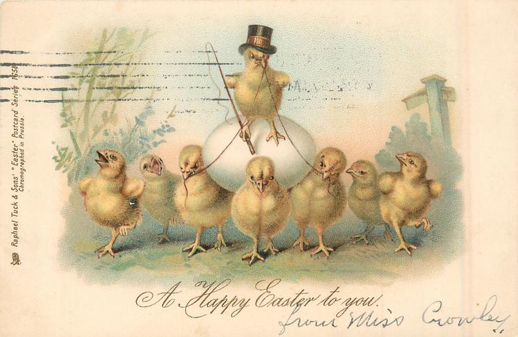A HAPPY EASTER TO YOU  chick wearing top hat sits on egg pulled by three chicks, others observe