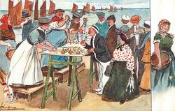 visitors enjoy freshly prepared sea-food on the promenade