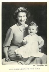H.R.H. PRINCESS ELIZABETH AND PRINCE CHARLES woman and baby both looking forward, baby sitting on woman's lap