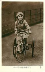 H.R.H PRINCESS ELIZABETH riding tricycle