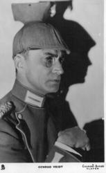 CONRAD VEIDT faces right, dense shadow