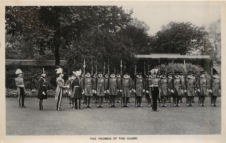 THE YEOMEN  OF THE GUARD all drawn up on parade in front of building, most face front, officers left
