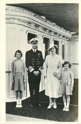 King George VI., Queen Elizabeth, two Princesses, appear to be on a ship