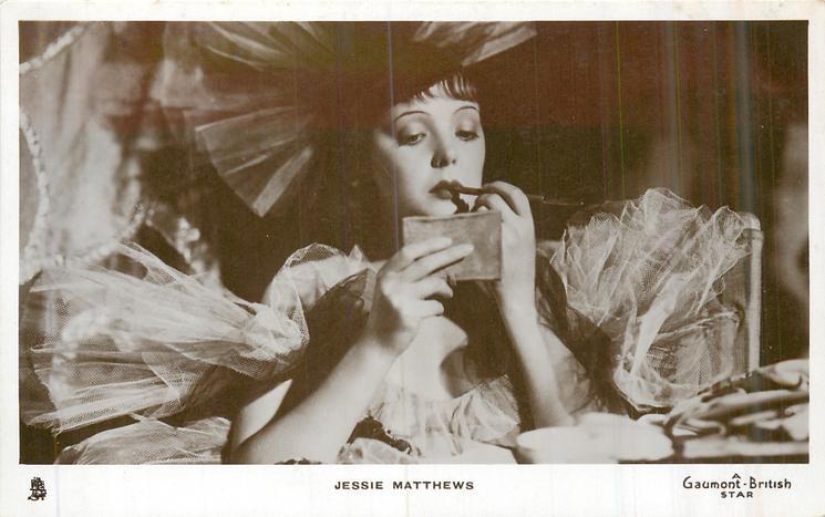 JESSIE MATTHEWS appliying lip-stick