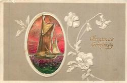 CHRISTMAS GREETINGS oval inset of sailing ship on green ocean, red sky, embossed pansies in light brown surround