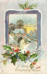 A HAPPY CHRISTMAS TO YOU purple edged inset of winter scene, bridge over river, houses & church behind, holly below
