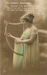 THE SEASON'S GREETINGS  girl facing left plays old style harp, cloth draped over her right arm