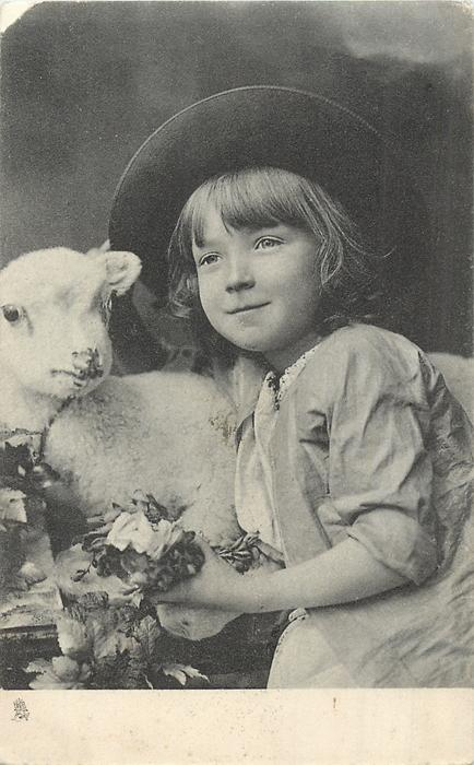child facing half left, looking up left, left hand  visible, toy lamb's head left