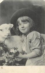child facing half left, looking up left, left hand  visible, toy lamb's head left