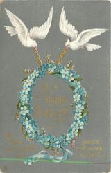 A HAPPY BIRTHDAY  two white doves carry chain of blue forget-me-nots