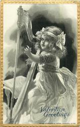 young girl facing left playing harp