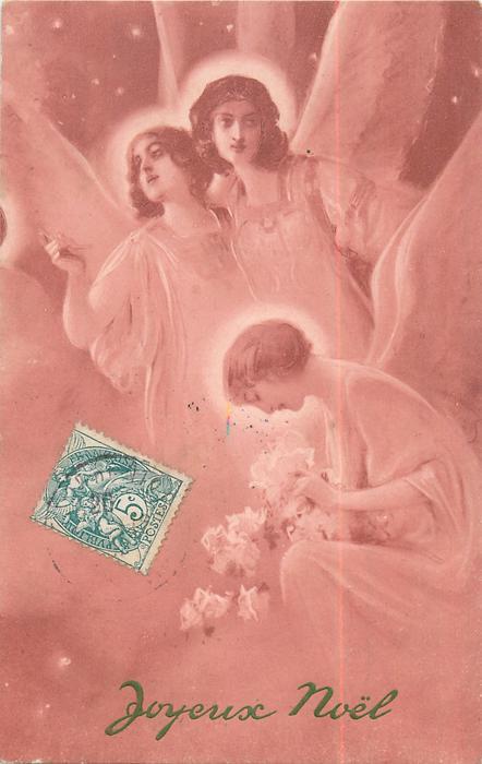 three angels, two behind kneeling angel examining flowers