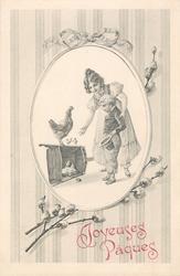 girl and smaller boy look at hen standing on upset wheelbarrow, chicks around