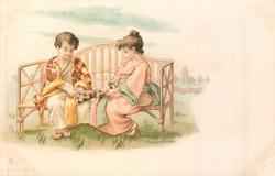 two Japanese children sit on bamboo seat