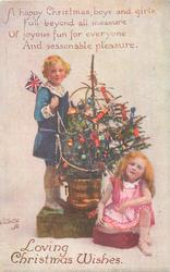 LOVING CHRISTMAS WISHES boy & girl on each side of Xmas tree