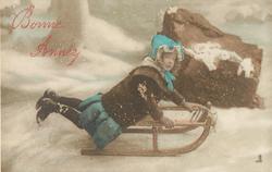girl on toboggan in snowy scene