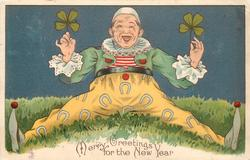 MERRY GREETINGS FOR THE NEW YEAR clown with legs widely spread, holding two 4 leaf clovers