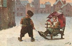boy faces away pulling sled with girl seated in it holding red umbrella over her right shoulder