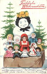 snow person stands with 10 dolls for sale, tree behind & below