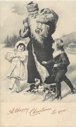 A HAPPY CHRISTMAS TO YOU  Santa in black robe, 2 children, toys in sack & dog, in a snowy field