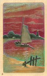 very shiny, metallic painted card with sailing boat, lighthouse, red sky & water