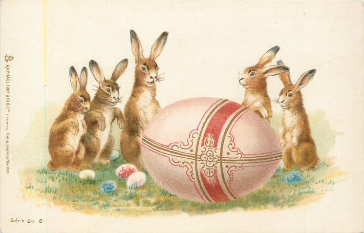 large pink Easter egg in front of 5 rabbits