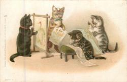 one cat paints, another stands back, two kittens read