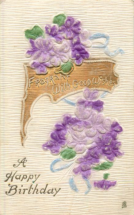 A HAPPY BIRTHDAY,  FRAGRANT WITH GOOD WISHES on gilt plaque, violets above & below