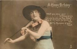 A HAPPY BIRTHDAY pretty girl in large hat plays violin, facing left & looking front & up