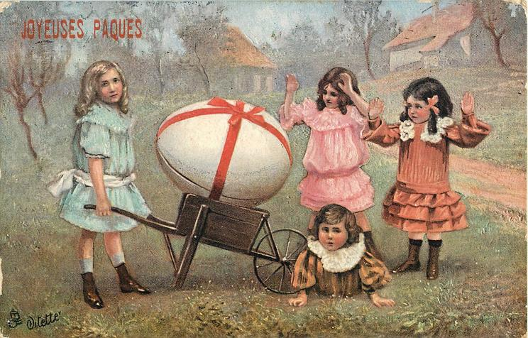 4 girls with very large white egg on wheelbarrow