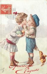 girl carrying 2 coloured eggs left kisses boy right,  chick pullseggs at his pants