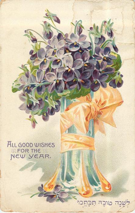 ALL GOOD WISHES FOR THE NEW YEAR violets in glass vase wrapped in orange ribbon with bows
