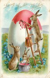 LOVING EASTER WISHES rabbit on ladder paints giant egg, 2 other rabbits below