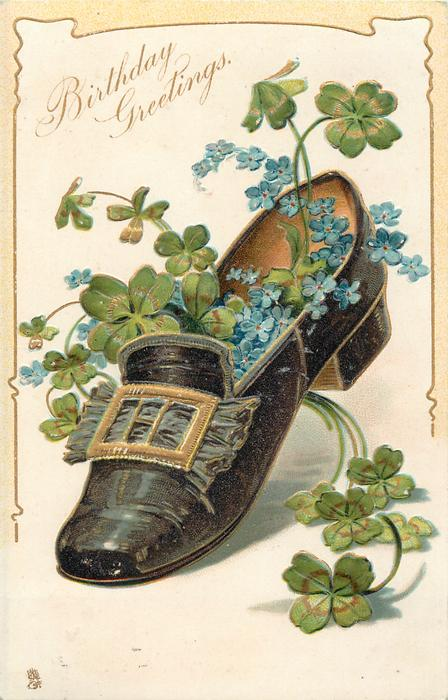 BIRTHDAY GREETINGS  forget-me-nots and four leaf clover in black shoe with gold buckle