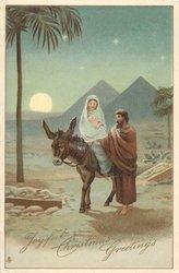 JOYFUL CHRISTMAS GREETINGS, Jesus & Mary ride donkey in desert in front of pyramids, evening scene
