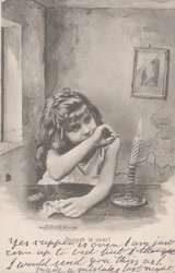 young girl sitting at table by candlelight, the back of her hand is lifted over her mouth