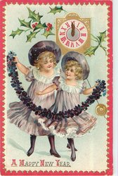 two girls in lilac dresses hold rope made of violets, clock & holly above