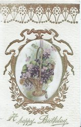 A HAPPY BIRTHDAY in gilt silk inset of violets hanging in basket, ornate gilt desisigns around silk & at top