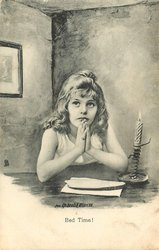 young girl praying by candlelight
