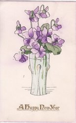 A HAPPY NEW YEAR in gilt, purple violets in tall vase