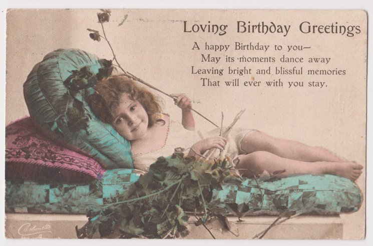 LOVING BIRTHDAY GREETINGS child lies on pillows with tree branch