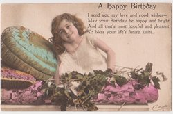 A HAPPY BIRTHDAY girl leans on pillows with tree branches
