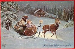 light brown robed Santa & girl driving sled pulled  right by deer