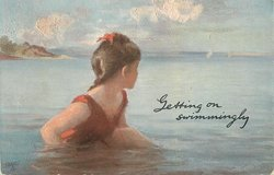 GETTING ON SWIMMINGLY, young girl in red bathing suit sits in sea looking at the horzon